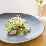 Cured & seared bonito with pickled baby cucumber, crispy potato & rock oyster dressing