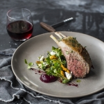 Junee lamb rack with beetroot purée, chargrilled zucchini, goat's cheese, currants & pine nuts