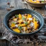 Tapioca porridge with mango, almond milk & pecans