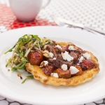 Tomato tarte tatin with goats cheese and pear salad